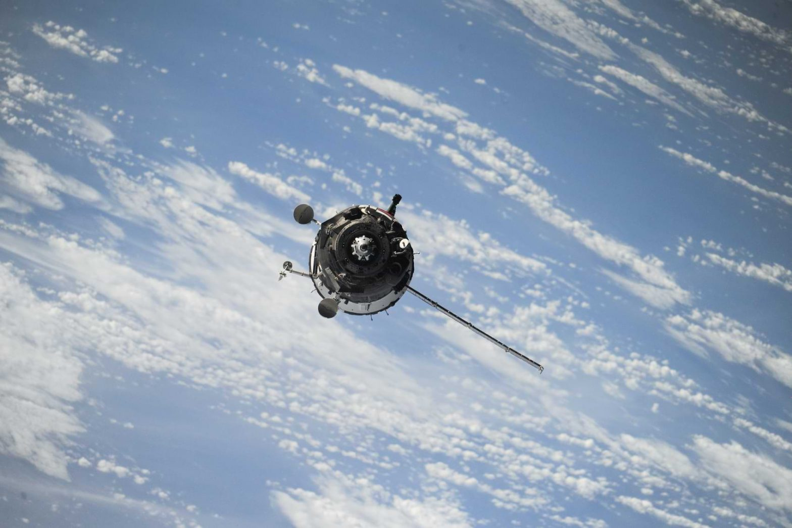 A satellite orbits the Earth, providing internet access and information to the people down below.
