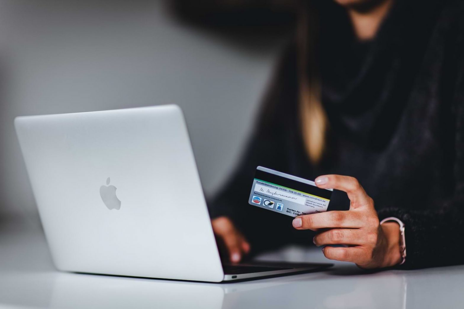 A woman enters her credit card information as she prepares to pay for a new internet plan.